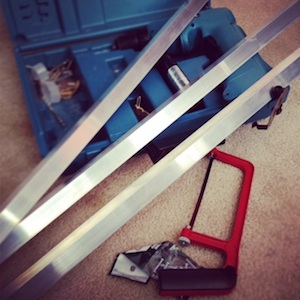 """Tools and 3 - 30"""" inch pieces of L bracket aluminum"""